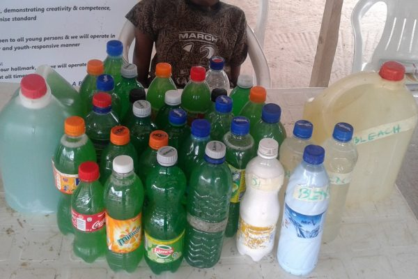 Young people displaying the varieties of Soaps they produced at the PAANEAH Skill Acquisition session
